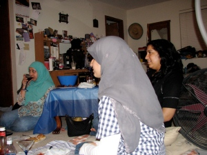 Farah Ali, Farah Naz and Bushra Naz watch the polling results come in.