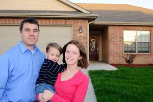 Kris and Heather Carmichael with their son Kolton stand outside their newly purchased home in northeast Columbia on Monday, Sept. 28. The Carmichaels were able to take advantage of an $8,000 federal incentive for first-time home buyers. (CM/Jason Lenhart)